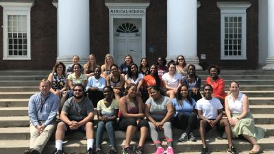 mhirt students and faculty sitting on steps