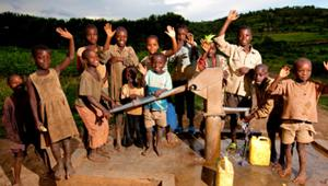Kids in Rwanda around water pump